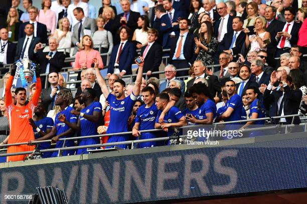 Thibaut Courtois of Chelsea lifts the Emirates FA Cup trophy in celebration of his side's win with team mates following The Emirates FA Cup Final...