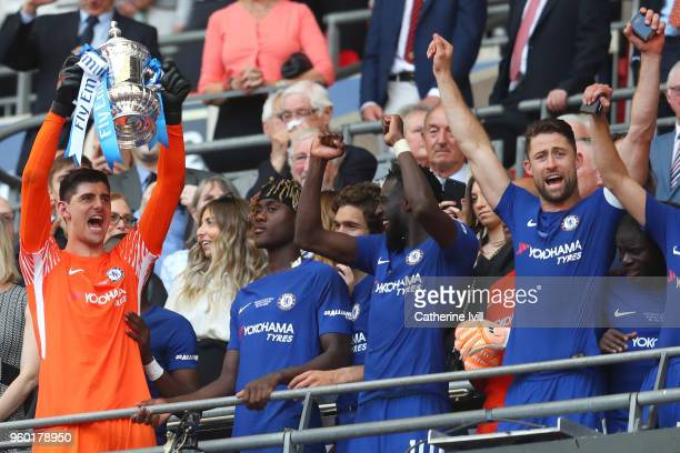 Thibaut Courtois of Chelsea lifts the Emirates FA Cup trophy in celebration of his side's victory during The Emirates FA Cup Final between Chelsea...