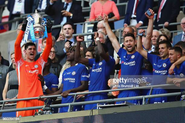 Thibaut Courtois of Chelsea lifts the FA Cup trophy after his side won during the Emirates FA Cup Final between Chelsea and Manchester United at...