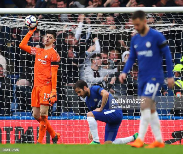 Thibaut Courtois of Chelsea looks dejected after conceding a goal during the Premier League match between Chelsea and West Ham United at Stamford...