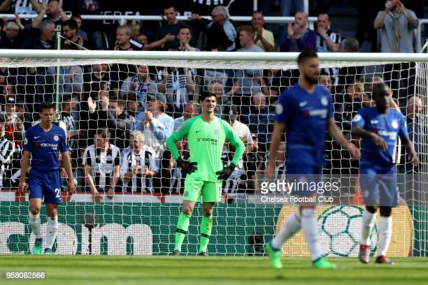 Thibaut Courtois of Chelsea looks dejected during the Premier League match between Newcastle United and Chelsea at St James Park on May 13 2018 in...