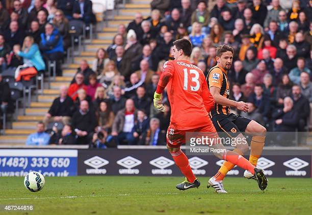 Thibaut Courtois of Chelsea loses the ball under pressure from Gaston Ramirez of Hull City to allow Abel Hernandez of Hull City to score their second...