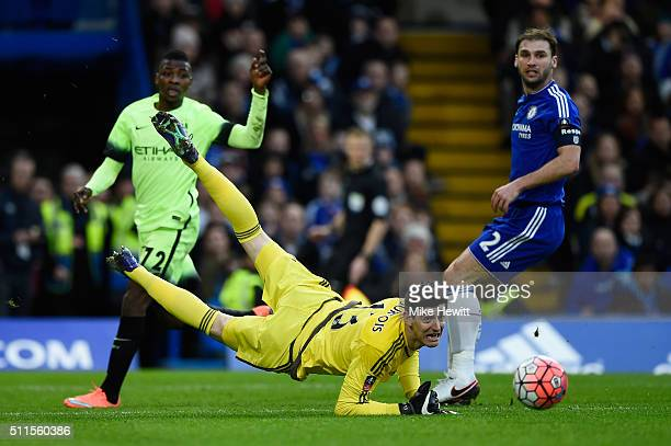 Thibaut Courtois of Chelsea makes a save from Kelechi Iheanacho of Manchester City during The Emirates FA Cup fifth round match between Chelsea and...