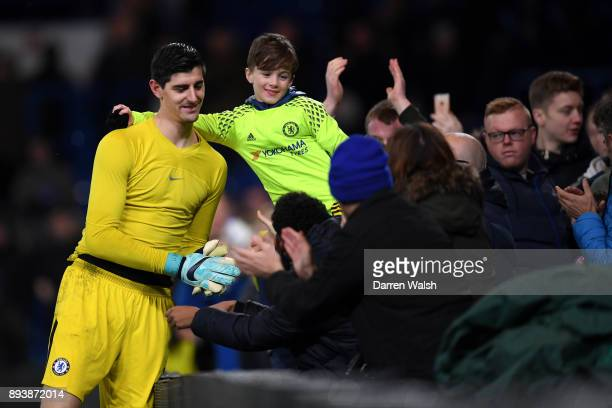 Thibaut Courtois of Chelsea poses for a photograph with a fan after the Premier League match between Chelsea and Southampton at Stamford Bridge on...
