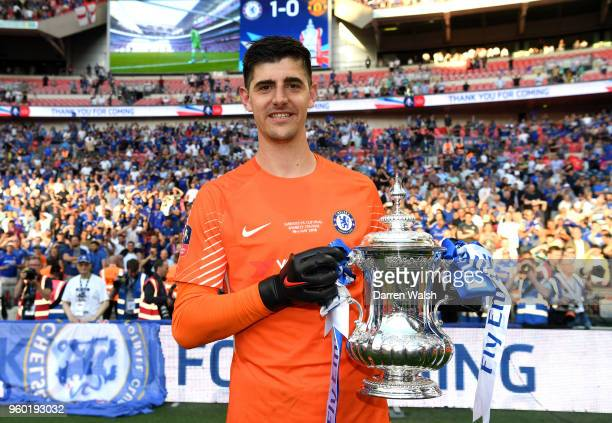 Thibaut Courtois of Chelsea poses with the Emirates FA Cup trophy following his side's victory during The Emirates FA Cup Final between Chelsea and...