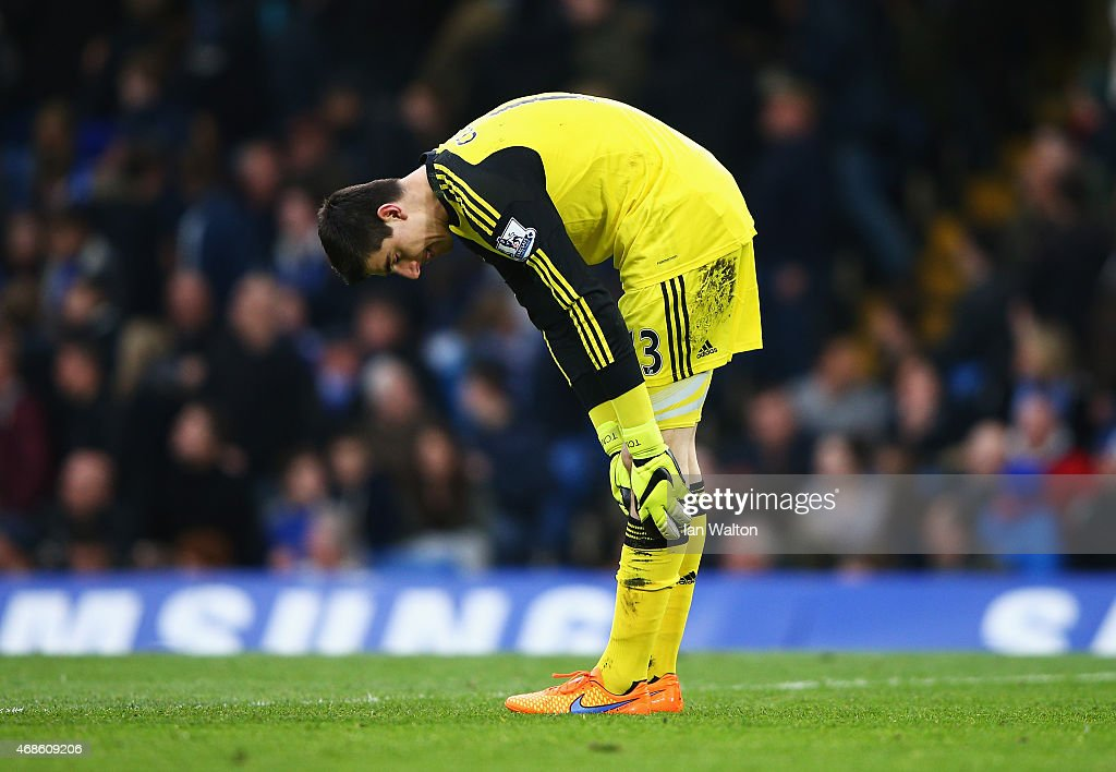 Thibaut Courtois of Chelsea reacts after conceding a goal scored by Charlie Adam of Stoke City during the Barclays Premier League match between Chelsea and Stoke City at Stamford Bridge on April 4, 2015 in London, England.