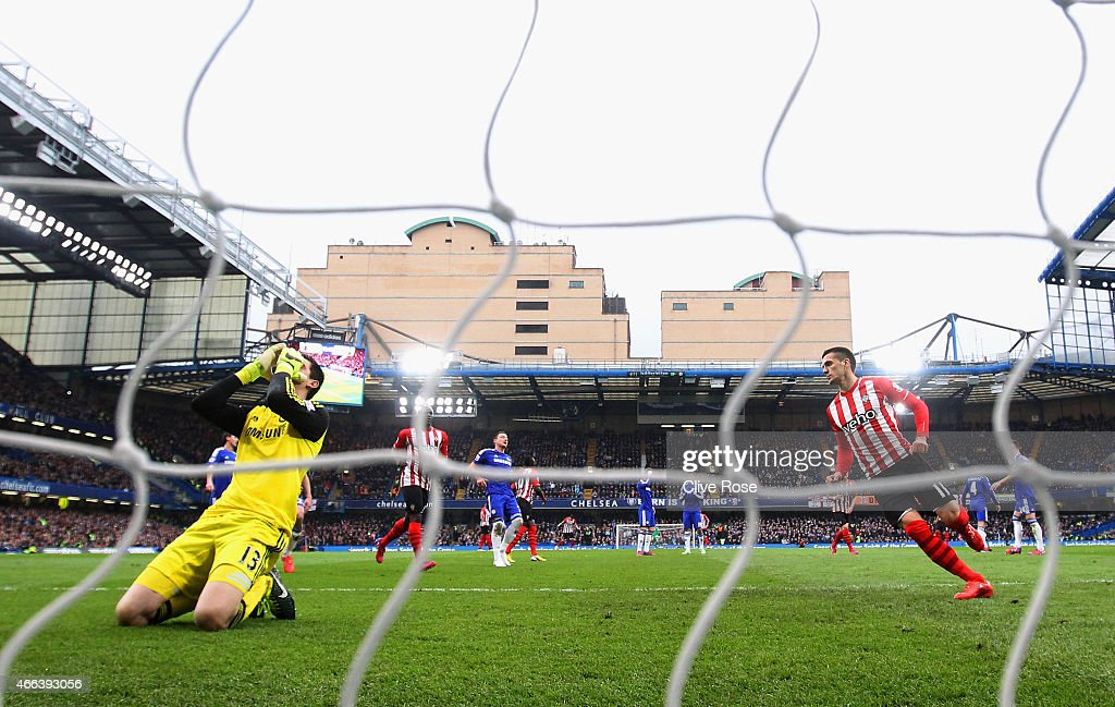 Thibaut Courtois of Chelsea reacts after Dusan Tadic of Southampton (R) scored their first goal from the penalty spot during the Barclays Premier League match between Chelsea and Southampton at Stamford Bridge on March 15, 2015 in London, England.