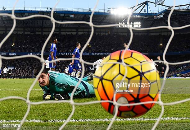 Thibaut Courtois of Chelsea reacts after Kevin Mirallas of Everton scoring his team's second goal during the Barclays Premier League match between...