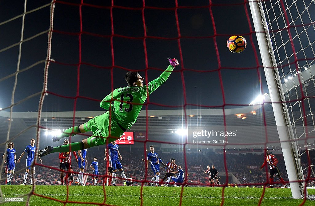 Thibaut Courtois of Chelsea saves a shot by Patrick van Aanholt of Sunderland during the Premier League match between Sunderland and Chelsea at Stadium of Light on December 14, 2016 in Sunderland, England.