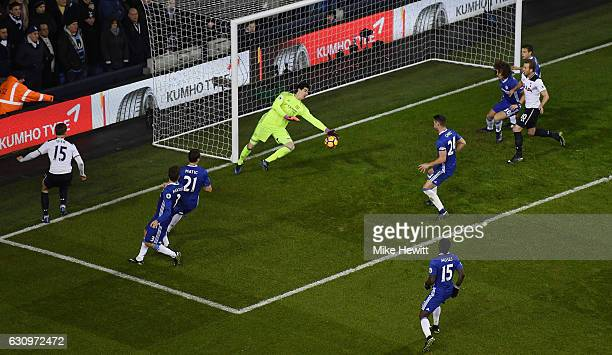 Thibaut Courtois of Chelsea saves a shot from Eric Dier of Tottenham Hotspur during the Premier League match between Tottenham Hotspur and Chelsea at...