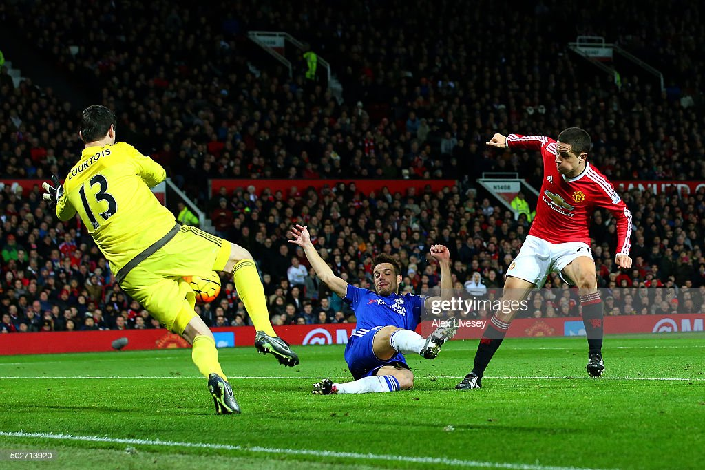 Thibaut Courtois of Chelsea saves an effort from Ander Herrera of Manchester United as Cesar Azpilicueta of Chelsea slides in during the Barclays Premier League match between Manchester United and Chelsea at Old Trafford on December 28, 2015 in Manchester, England.