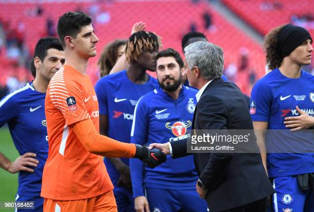 Thibaut Courtois of Chelsea shakes hands with Jose Mourinho Manager of Manchester United following The Emirates FA Cup Final between Chelsea and...