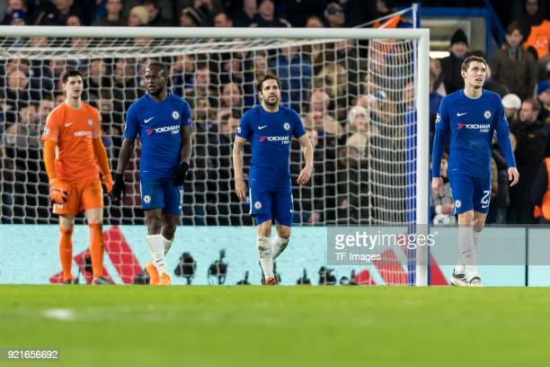 Thibaut Courtois of Chelsea Victor Moses of Chelsea Cesc Fabregas of Chelsea and Andreas Christensen of Chelsea looks dejected during the UEFA...