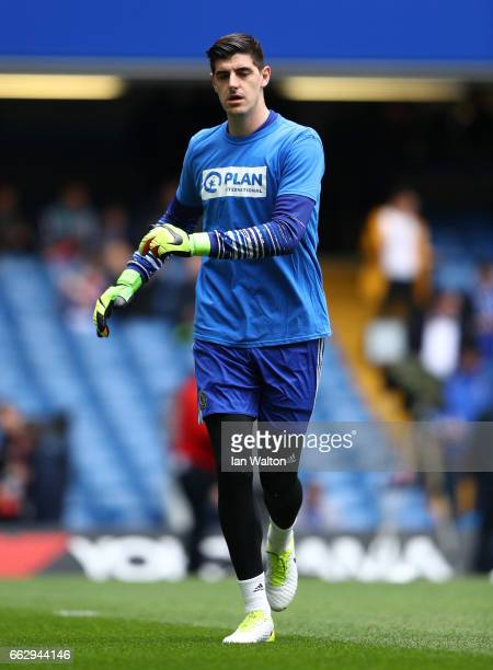 Thibaut Courtois of Chelsea warms up prior to the Premier League match between Chelsea and Crystal Palace at Stamford Bridge on April 1 2017 in...