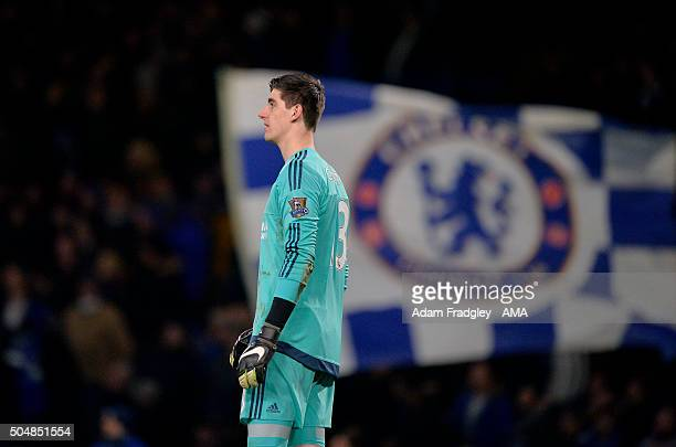 Thibaut Courtois of Chelsea with a Chelsea flag flying in the stands behind during the Barclays Premier League match between Chelsea and West...
