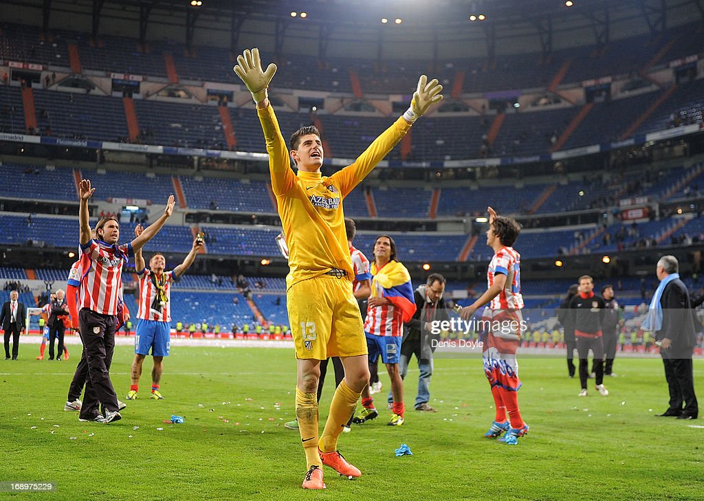 Thibaut Courtois of Club Atletico de Madrid celebrates after Atletico beat Real Madrid 2-1 in the Copa del Rey Final at Estadio Santiago Bernabeu on May 17, 2013 in Madrid, Spain.