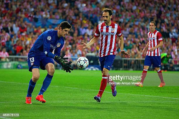 Thibaut Courtois of Club Atletico de Madrid collects the ball during the UEFA Champions League Quarter Final second leg match between Club Atletico...