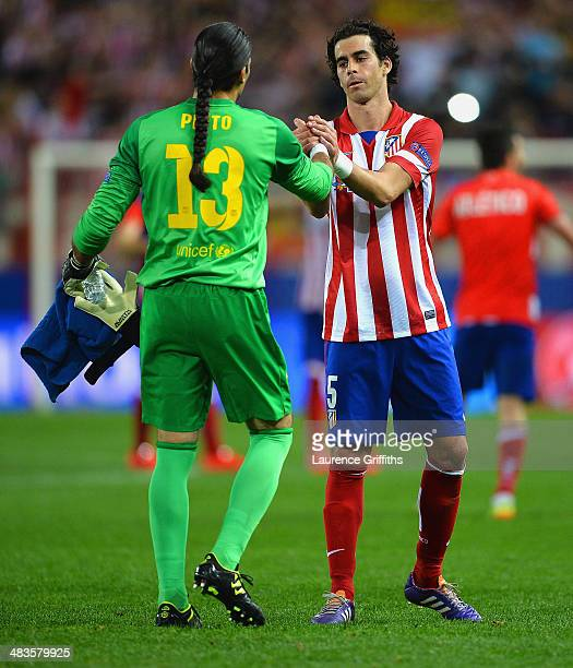 Thibaut Courtois of Club Atletico de Madrid shakes hands with Tiago of Club Atletico de Madrid during the UEFA Champions League Quarter Final second...