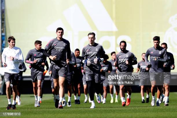 Thibaut Courtois of Real Madrid and his team mates train during the Real Madrid training session at Valdebebas training ground on September 27, 2020...
