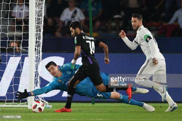 Thibaut Courtois of Real Madrid and Hussein Elshahat of Al Ain compete for the ball during the FIFA Club World Cup UAE 2018 Final between Real Madrid...