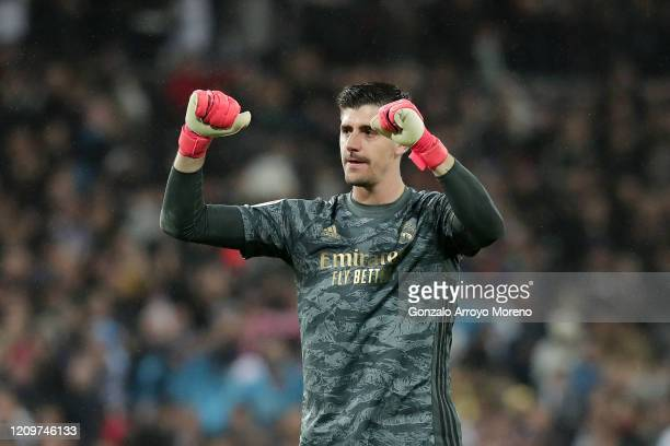 Thibaut Courtois of Real Madrid celebrates following his sides victory in the Liga match between Real Madrid CF and FC Barcelona at Estadio Santiago...