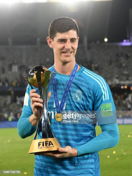 Thibaut Courtois of Real Madrid celebrates with the trophy after the match between Real Madrid and Al Ain on December 22 2018 in Abu Dhabi United...
