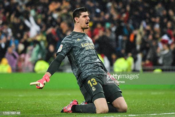 Thibaut Courtois of Real Madrid CF celebrates after his team mate Rodrygo scored his team's second goal during the Liga match between Real Madrid CF...