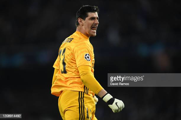Thibaut Courtois of Real Madrid CF celebrates after Isco of Real Madrid CF scored his team's first goal during the UEFA Champions League round of 16...