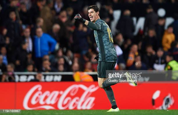 Thibaut Courtois of Real Madrid CF celebrates scoring his team's goal during the Liga match between Valencia CF and Real Madrid CF at Estadio...