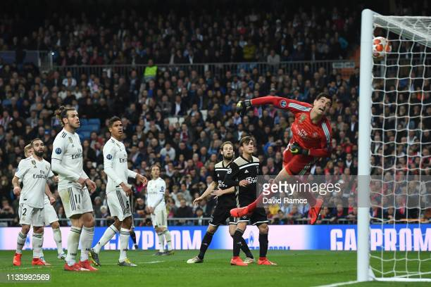 Thibaut Courtois of Real Madrid CF fails to save a goal from Lasse Schone of Ajax during the UEFA Champions League Round of 16 Second Leg match...