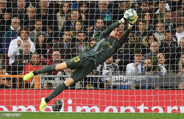 Thibaut Courtois of Real Madrid CF makes a save during the Liga match between Real Madrid CF and Real Betis Balompie at Estadio Santiago Bernabeu on...