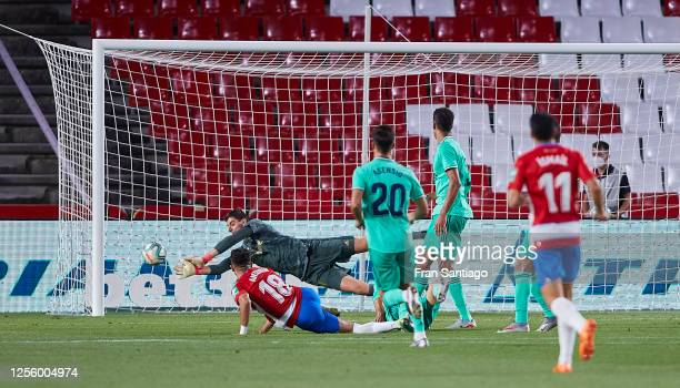 Thibaut Courtois of Real Madrid CF saves a shot during the Liga match between Granada CF and Real Madrid CF at on July 13 2020 in Granada Spain...