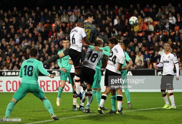 Thibaut Courtois of Real Madrid competes for the ball with Geoffrey Kondogbia of Valencia during the Liga match between Valencia CF and Real Madrid...