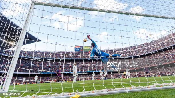 Thibaut Courtois of Real Madrid controls the ball during the La Liga match between FC Barcelona and Real Madrid CF at Camp Nou on October 28 2018 in...