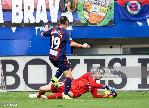 Thibaut Courtois of Real Madrid duels for the ball with Charles Dias de Oliveira of SD Eibar during the La Liga match between SD Eibar and Real...
