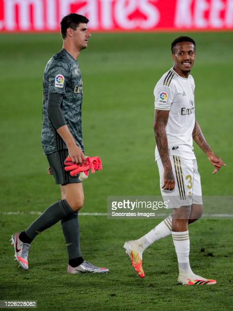 Thibaut Courtois of Real Madrid Eder Militao of Real Madrid during the La Liga Santander match between Real Madrid v Deportivo Alaves at the Stadium...