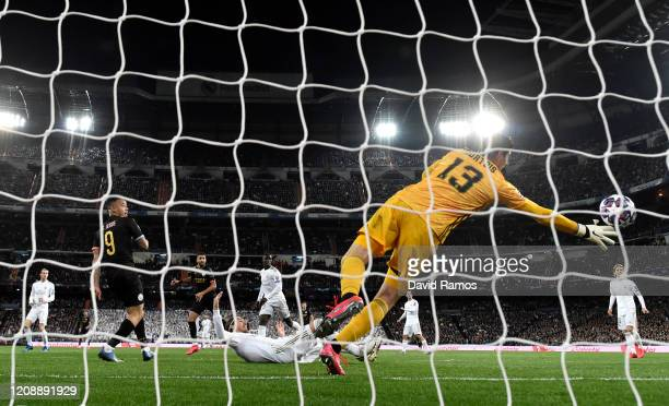 Thibaut Courtois of Real Madrid fails to save as Gabriel Jesus of Manchester City scores his team's first goal during the UEFA Champions League round...