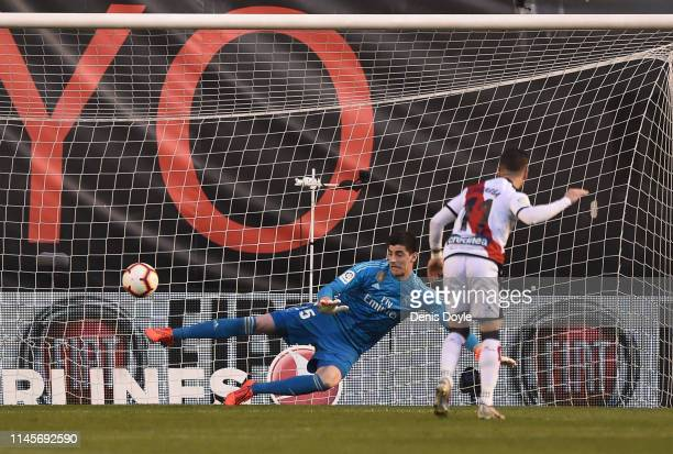 Thibaut Courtois of Real Madrid fails to save the penalty shot by Adri Embarba of Rayo Vallenco during the La Liga match between Rayo Vallecano de...