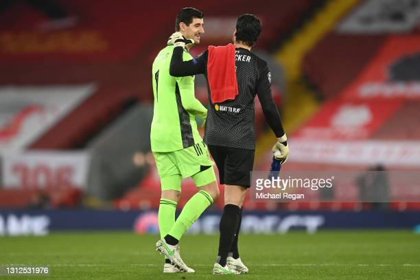 Thibaut Courtois of Real Madrid interacts with Alisson of Liverpool following the UEFA Champions League Quarter Final Second Leg match between...