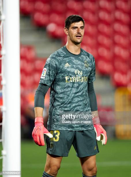 Thibaut Courtois of Real Madrid looks on during the Liga match between Granada CF and Real Madrid CF at Nuevo Los Carmenes on July 13 2020 in Granada...