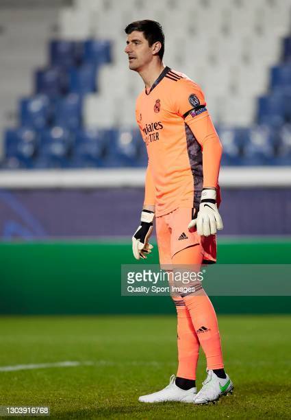 Thibaut Courtois of Real Madrid looks on during the UEFA Champions League Round of 16 match between Atalanta and Real Madrid at Gewiss Stadium on...