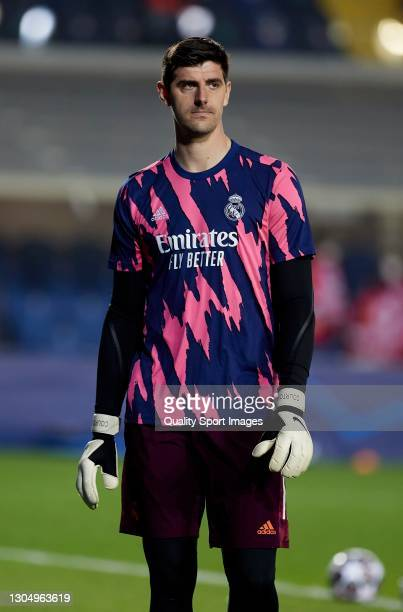 Thibaut Courtois of Real Madrid looks on prior to the UEFA Champions League Round of 16 match between Atalanta and Real Madrid at Gewiss Stadium on...
