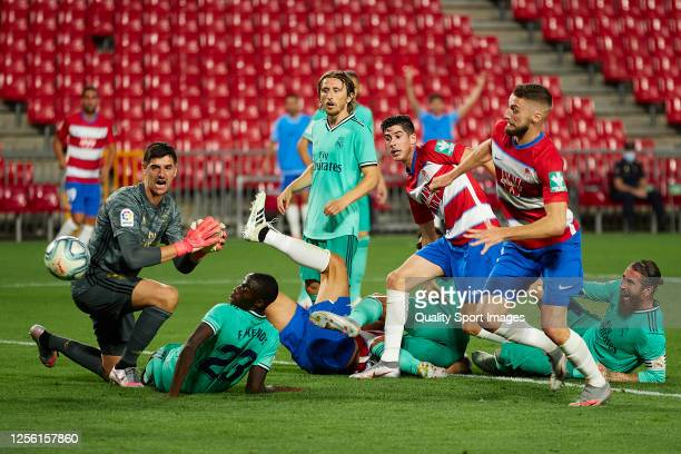Thibaut Courtois of Real Madrid loses the ball after a shot of Carlos Fernandez of Granada CF during the Liga match between Granada CF and Real...