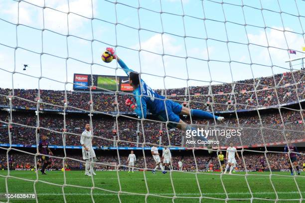 Thibaut Courtois of Real Madrid makes a save during the La Liga match between FC Barcelona and Real Madrid CF at Camp Nou on October 28 2018 in...
