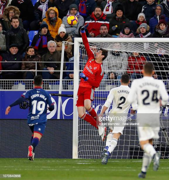 Thibaut Courtois of Real Madrid makes a save during the La Liga match between SD Huesca and Real Madrid CF at Estadio El Alcoraz on December 9 2018...