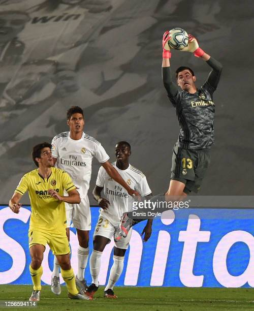 Thibaut Courtois of Real Madrid makes a save during the Liga match between Real Madrid CF and Villarreal CF at Estadio Alfredo Di Stefano on July 16...