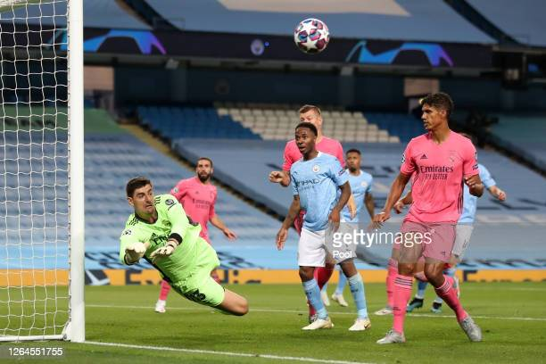Thibaut Courtois of Real Madrid makes a save during the UEFA Champions League round of 16 second leg match between Manchester City and Real Madrid at...