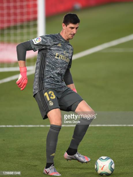 Thibaut Courtois of Real Madrid passes the ball during the Liga match between Real Madrid CF and Villarreal CF at Estadio Alfredo Di Stefano on July...