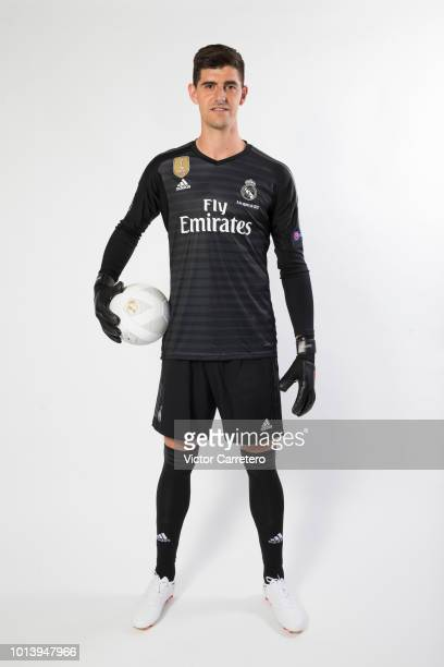 Thibaut Courtois of Real Madrid poses during his official presentation at Estadio Santiago Bernabeu on August 9 2018 in Madrid Spain
