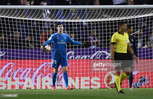 Thibaut Courtois of Real Madrid reacts as Anuar of Real Valladolid scores his team's first goal past during the La Liga match between Real Valladolid...